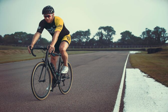 Chris Hoy cycling Lydden Hill circuit before testing in the rallycross car